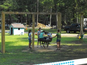 kids on the swings at shady brook campground