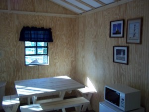 dining table and microwave in cabin