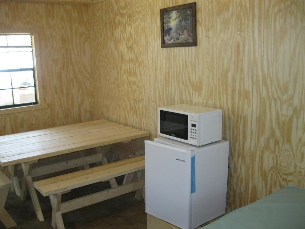 microwave and dining table in cabin
